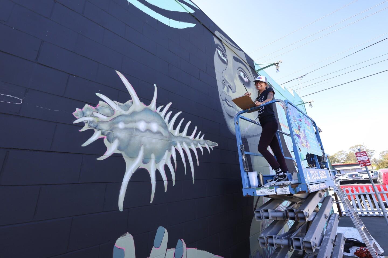 "Santa Cruz artist Caia Koopman works on her ""Ocean Acidification"" mural"
