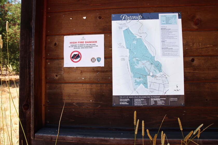 A sign warns that all off-trail activity is prohibited due to the high fire risk in Santa Cruz County.