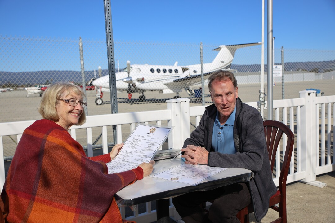 Patricia Bentson and Steve Mackintosh enjoy lunch with an aviation view at Ella's.