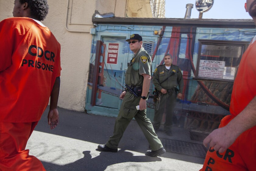 Guards monitor inmates at San Quentin Prison. Photo by Penni Gladstone for CalMatters