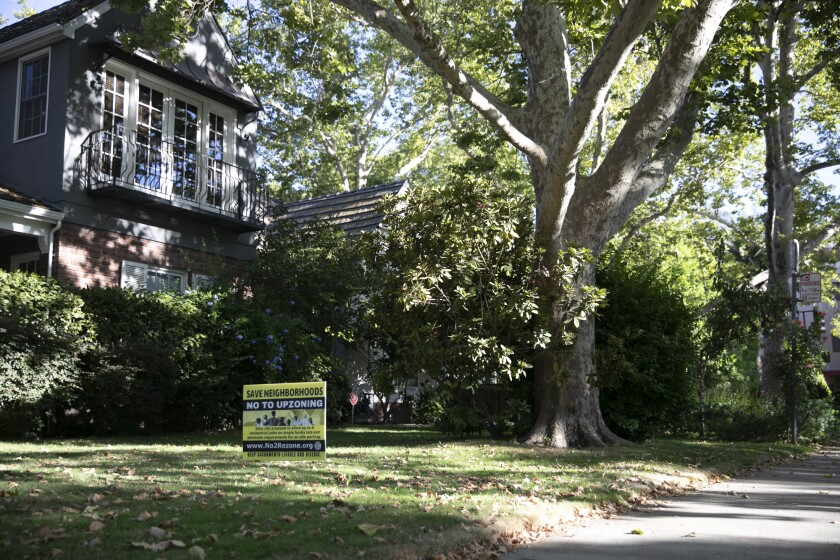 A 'No to upzoning' sign placed on the lawn of an East Sacramento home on Aug. 4. 2021. Photo by Anne Wernikoff, CalMatters