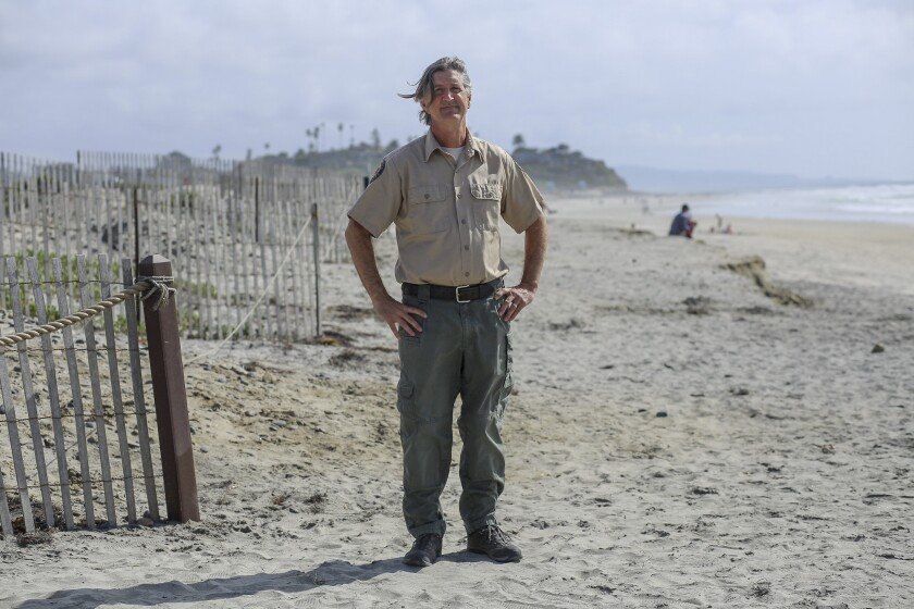 Darren Smith, Natural Resources and Environmental Planning Manager, stands for a portrait at South Ponto Beach on March 3, 2021. Photo by Shae Hammond for CalMatters
