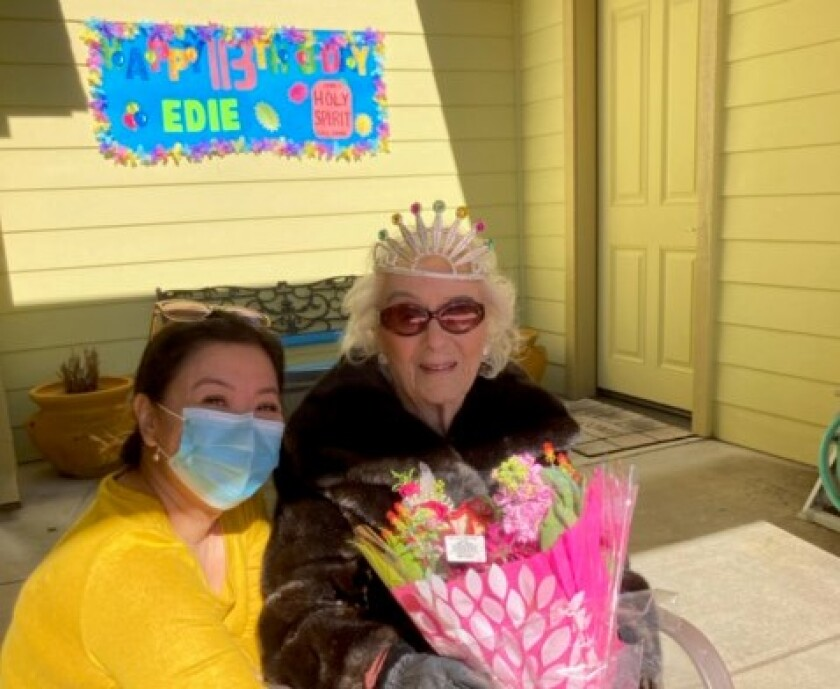 Edie Ceccarelli (right) and her primary caregiver Perla Gonzalez during a celebration for Ceccarelli's 113th birthday.