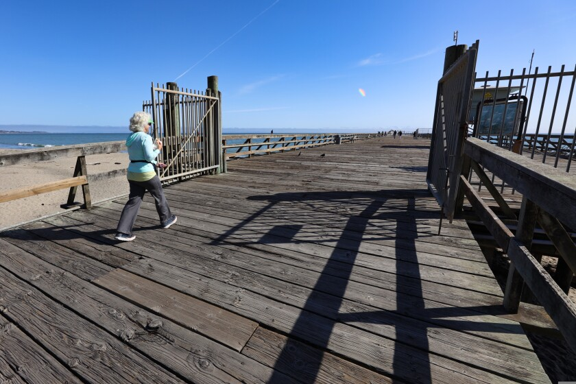 Erin Velikoff from Aptos enjoys a walk on the pier for the first time in well over a year.