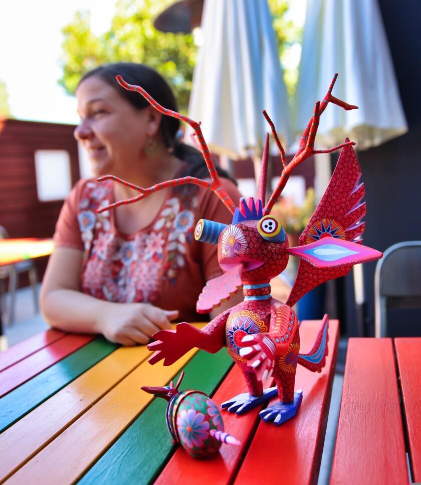 Alebrije, figurines characteristic of Oaxacan folk art, are a fixture at Copal.