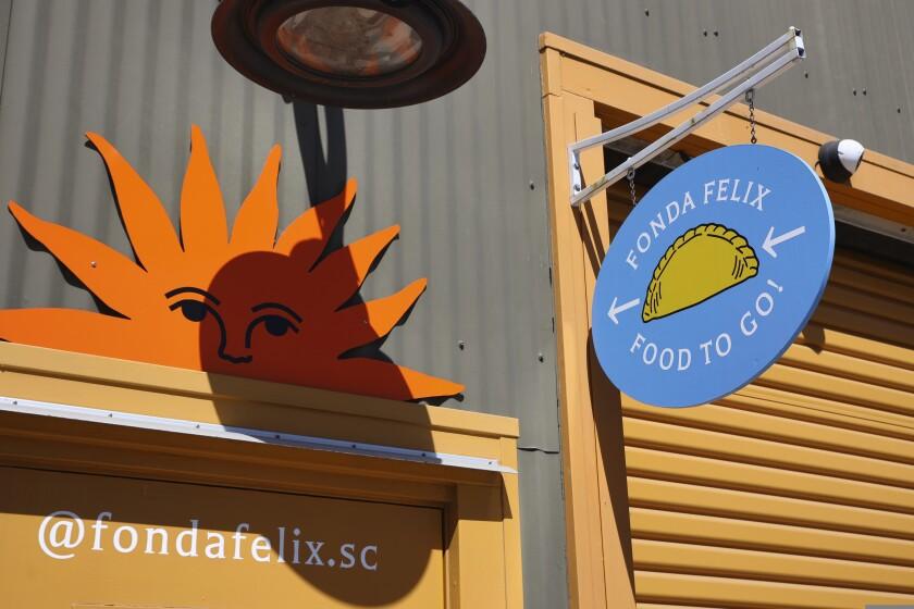 A closeup of the signage for Fonda Felix empanadas