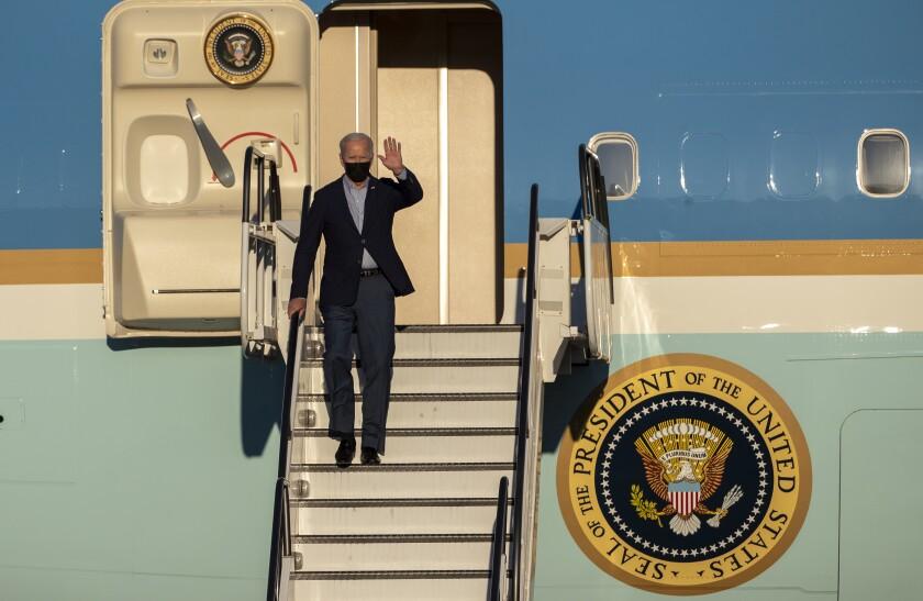 President Biden disembarks Air Force One after landing at Long Beach Airport