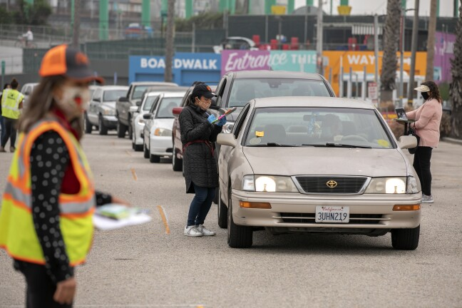 Cars line up near the Santa Cruz Boardwalk for the Second Harvest Food Bank of Santa Cruz.