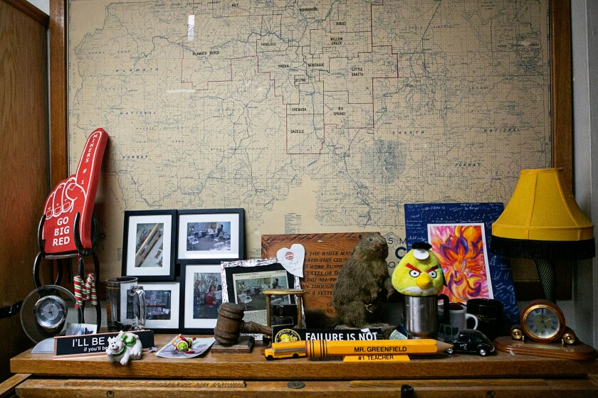 A map of the Yreka Union High School District hangs above a table.