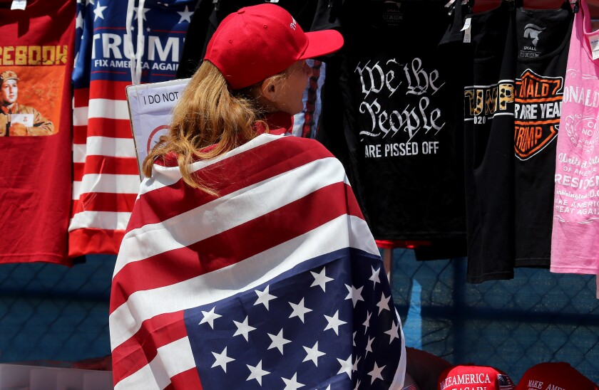 A woman draped in an American flag