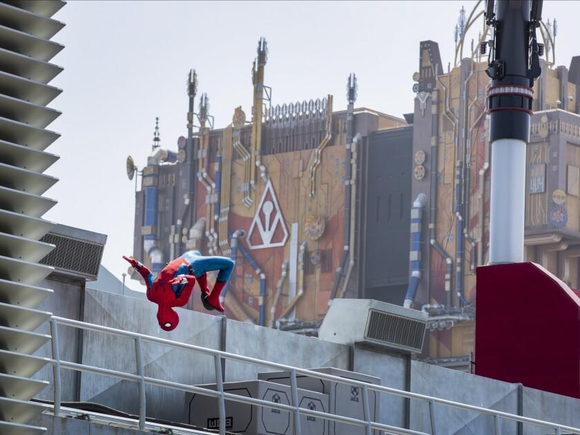 A robot Spider-Man does a backflip