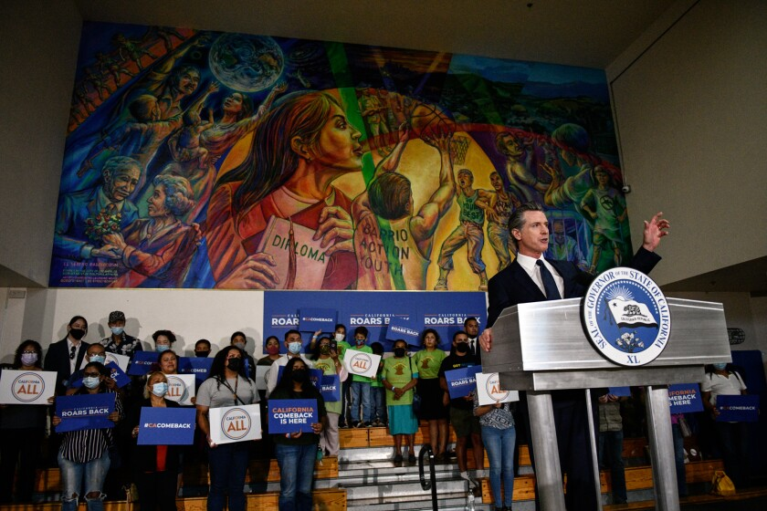 Gov. Gavin Newsom delivers a speech during a rally at the Barrio Action Youth and Family Center in El Sereno