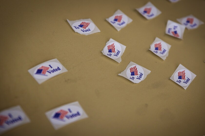 'I voted' stickers in English and Spanish
