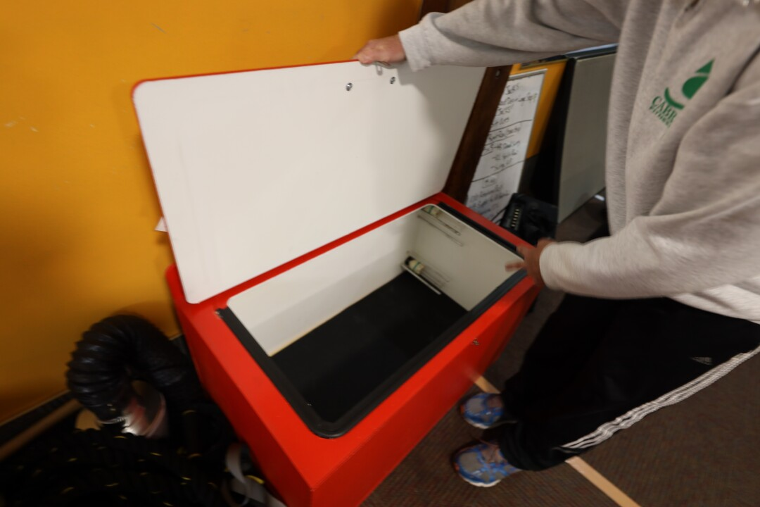 Cabrillo Fitness manager Shawn Johnston demonstrates a UV light technology bin.