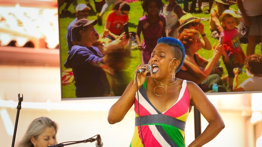 Singer Lisa Taylor performs on stage at the Juneteenth celebration at the London Nelson Community Center in Santa Cruz.