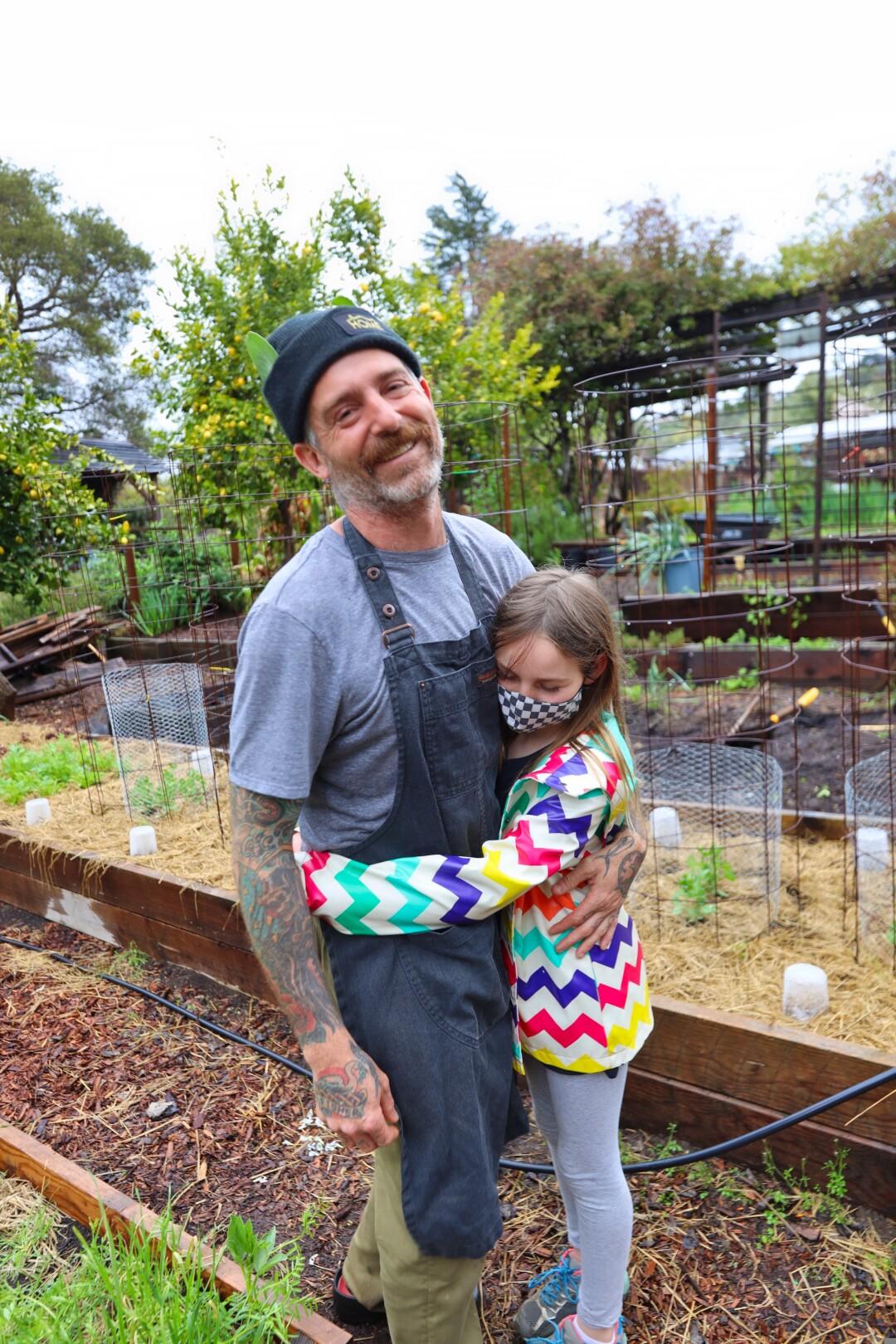 Dad gets a garden hug from Lola.