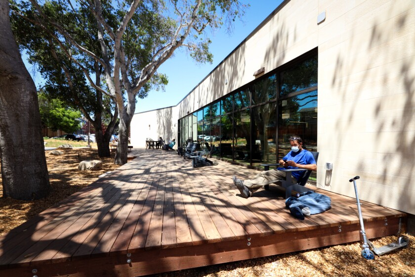 The deck area with Adirondack-style chairs adds space for reading and gathering at the new Capitola Branch Library.