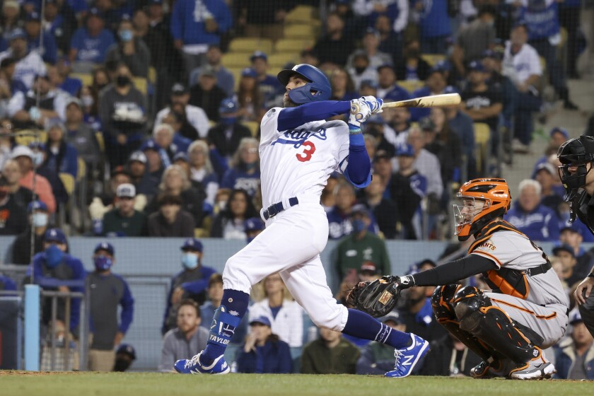 Los Angeles Dodgers' Chris Taylor hits a sacrifice fly in NLDS Game 4 against the San Francisco Giants