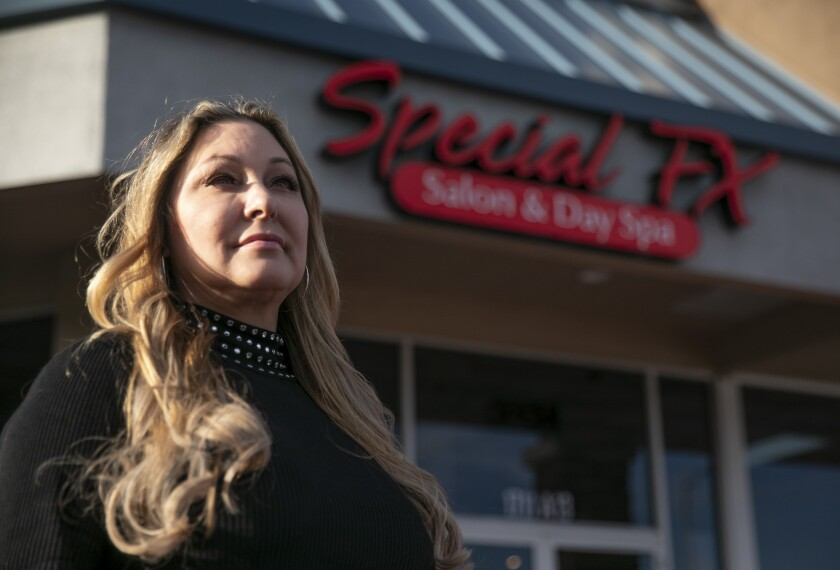 Denise Russell, owner of Special FX Salon & Day Spa in San Jose, is photographed outside of her salon on Jan. 15, 2020. Russell says she has had to close the salon for more than 7 months this year. Photo by Anne Wernikoff, CalMatters