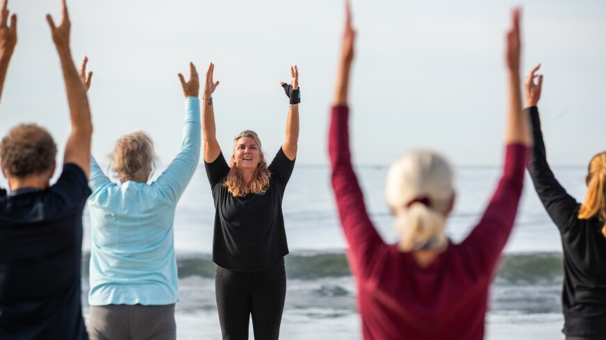 Instructor Melissa Mikolitch leads the outdoor yoga class at Twin Lakes Beach.