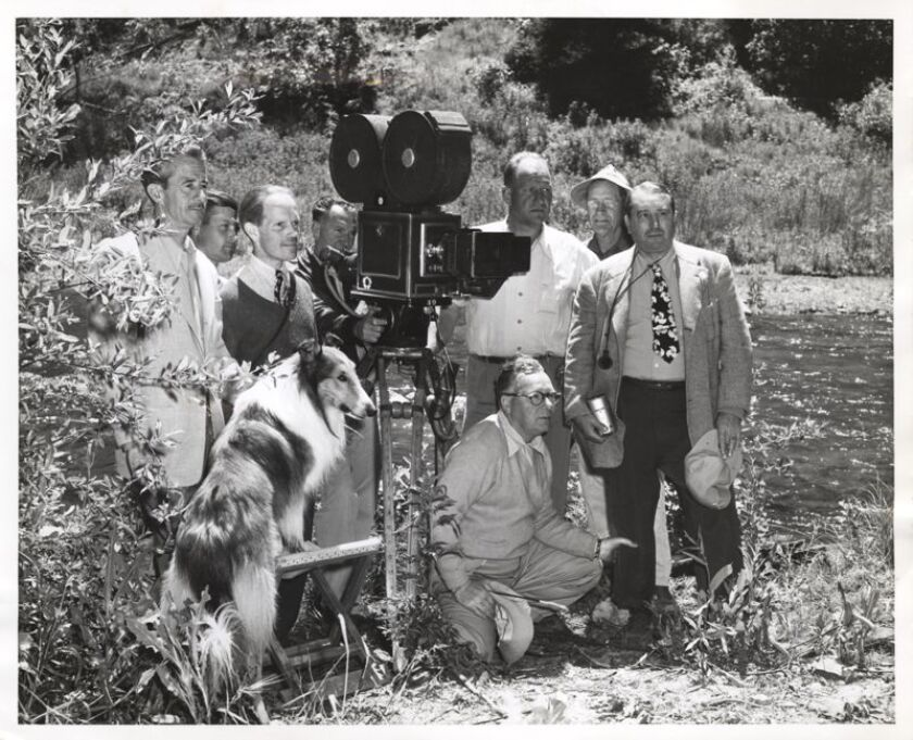 A historical photo of Preston Sawyer and a movie group on location.