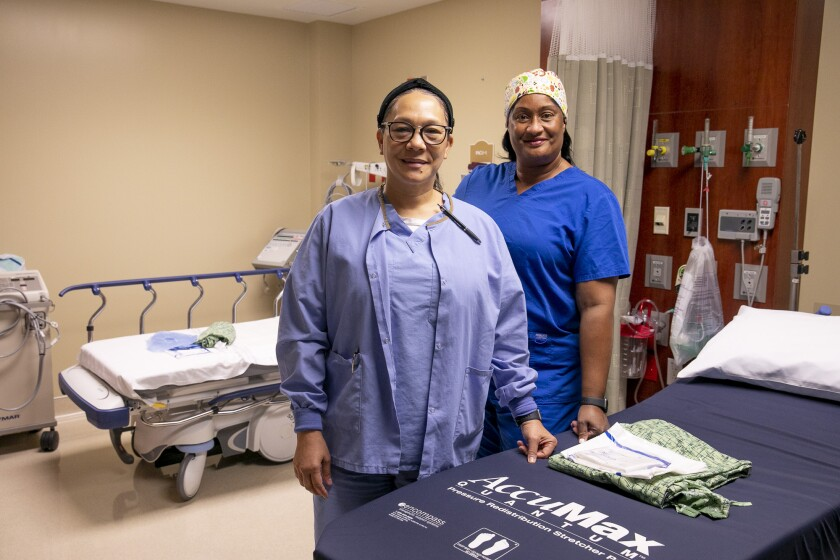 Nurses Janet Stovall, left, and Candace Brim, right, are based in North Carolina
