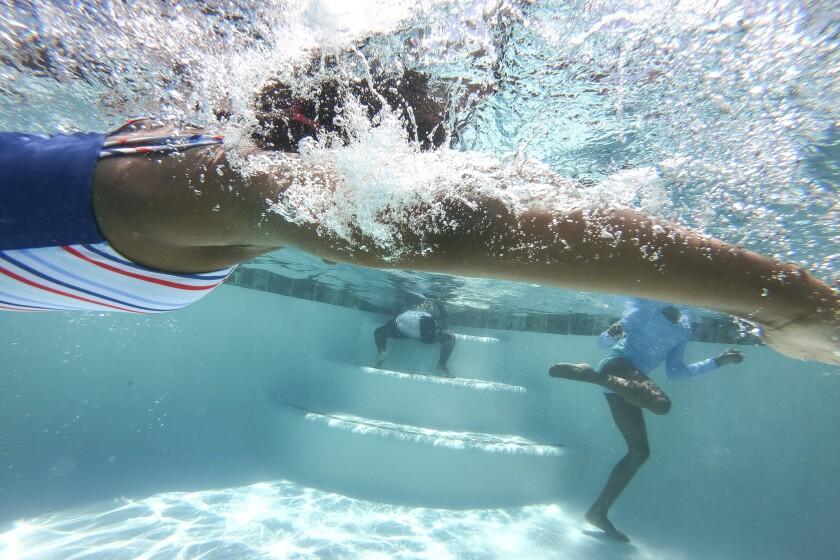 An underwater photo of kids swimming