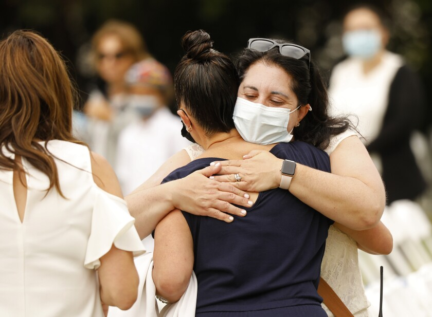Women hug during an outdoor Yom Kippur service in Los Angeles
