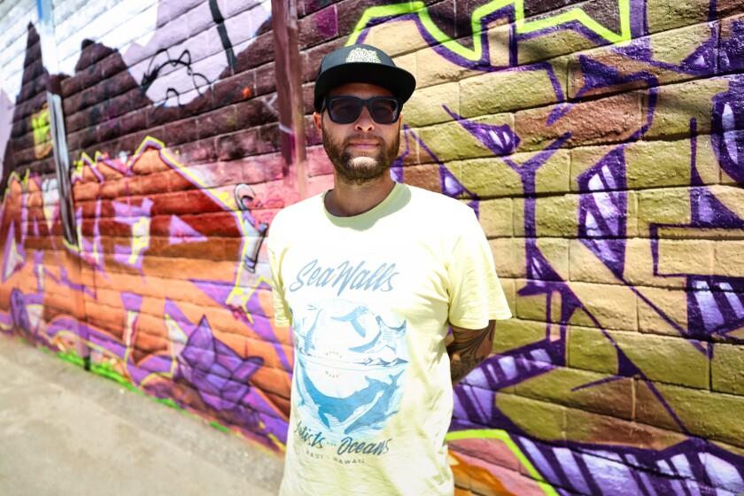 Artist Taylor Reinhold with a Made Fresh Crew mural in Santa Cruz