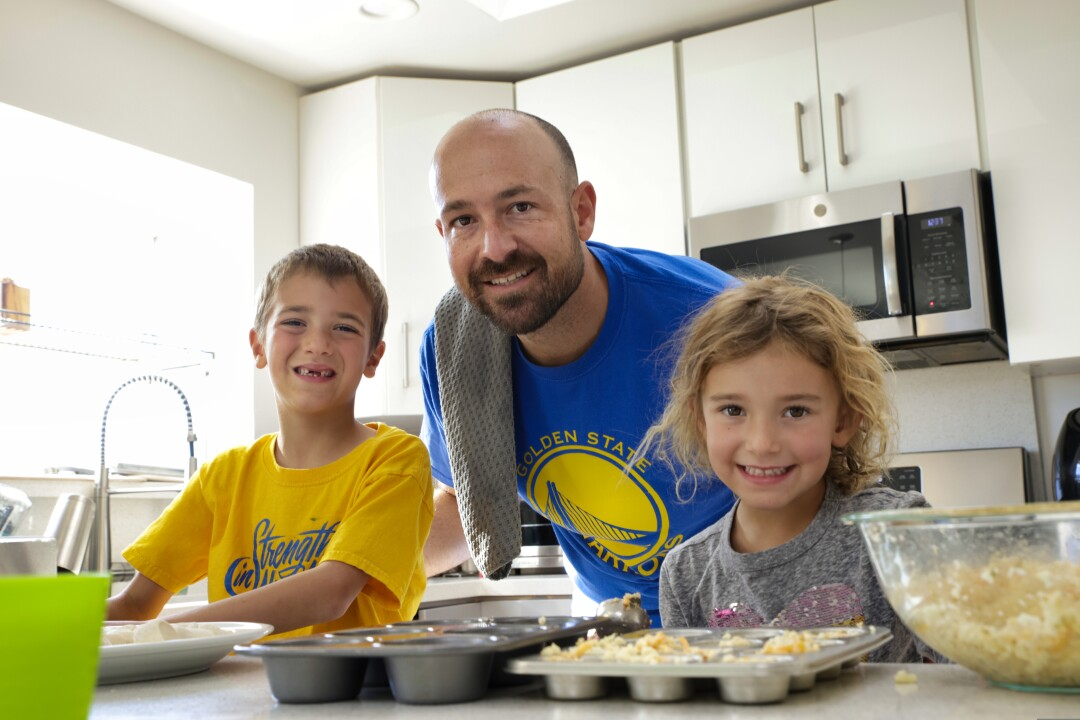 Santa Cruz Warriors GM Chris Murphy cooks Thanksgiving dinner with his son Connor, 6, and daughter Taylor, 4.