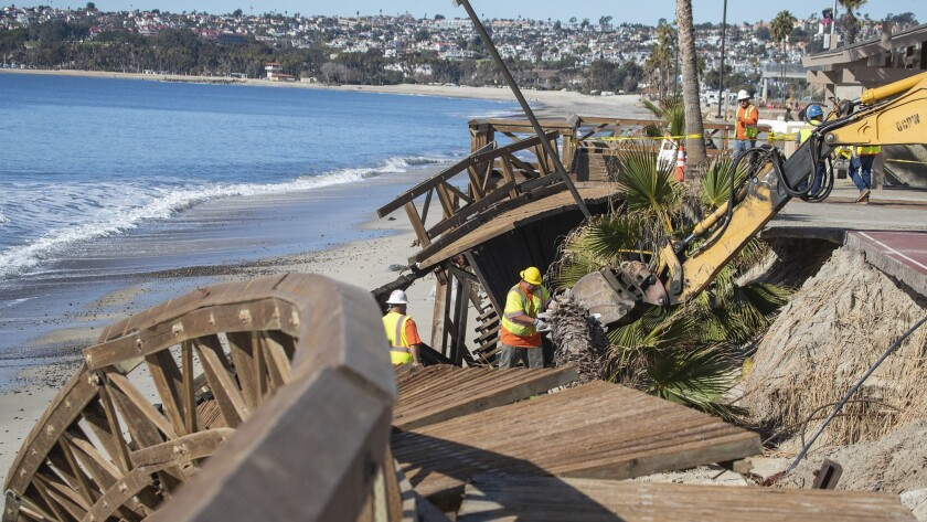 Damaged boardwalk at Capistrano Beach in Dana Point, after a big storm in 2018