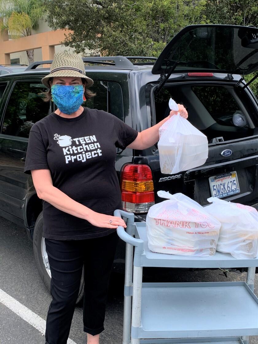 Volunteers delivering food.