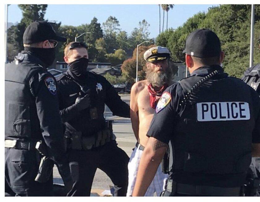Santa Cruz police confront Ole Hougen last year.