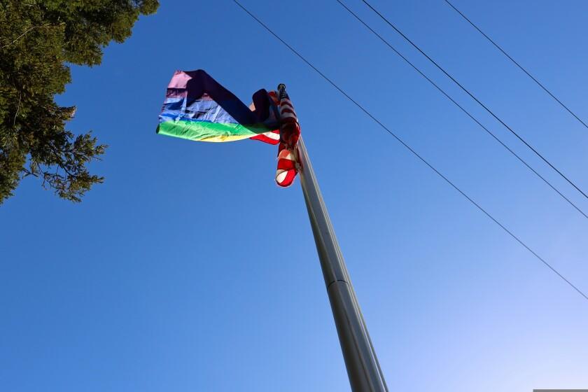 The Progress Pride Flag flies below the U.S. flag outside the Santa Cruz County Office of Education on Tuesday.