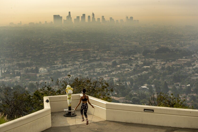 Carmen Green jumps rope at a closed Griffith Observatory.