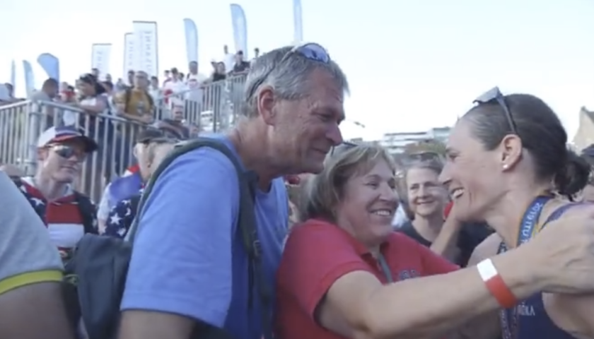 Katie celebrates her 2019 world championship with her parents.