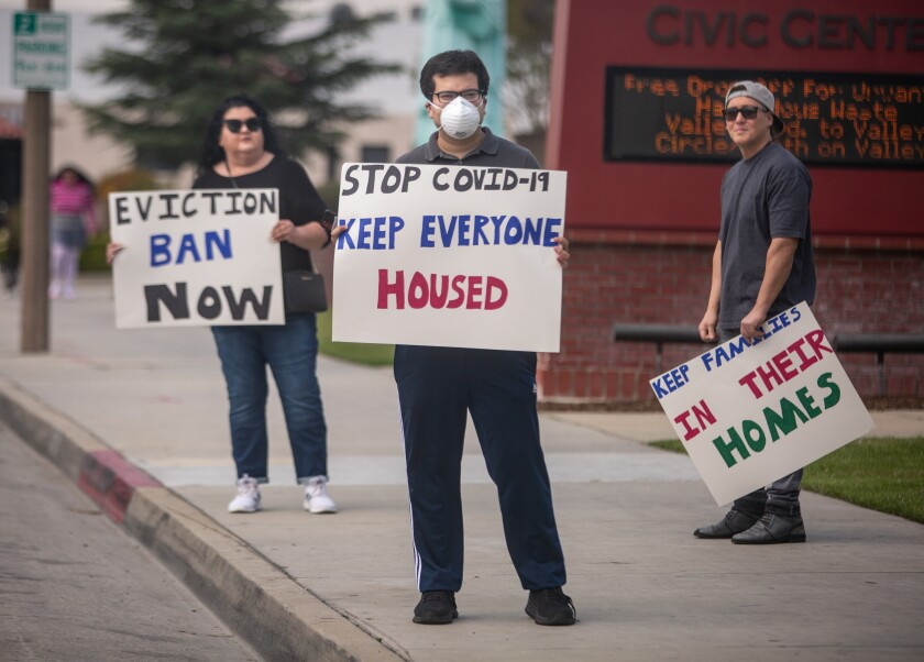 EL MONTE, CA - MARCH 29: Tenant rights activists assemble at the El Monte City Hall to demand that the El Monte City Council pass an eviction moratorium barring all evictions during the coronavirus pandemic on Sunday, March 29, 2020 in El Monte, CA. (Jason Armond / Los Angeles Times)