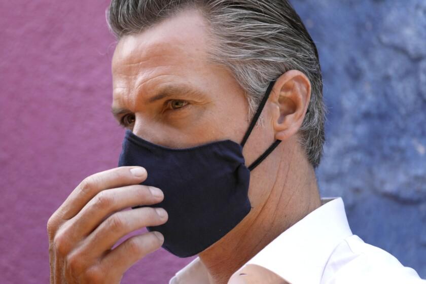 California Gov. Gavin Newsom wears a mask