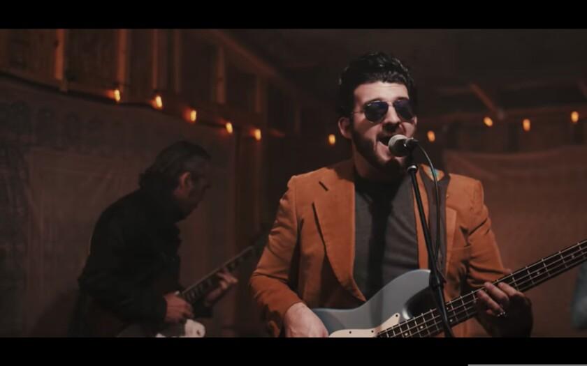 Santa Cruz's Alex Lucero in a screenshot from one of his music videos.