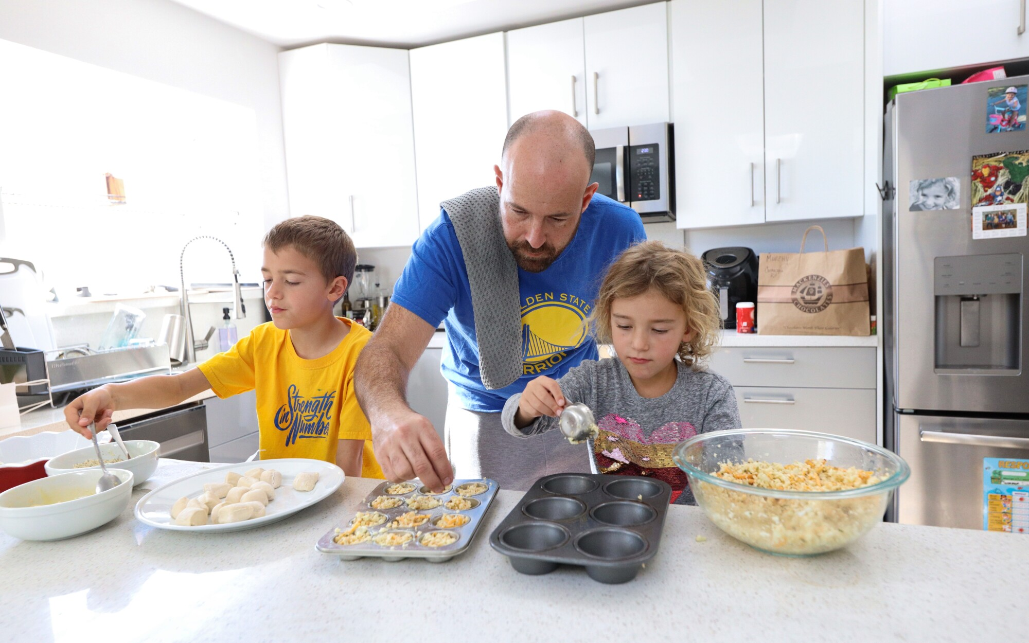 Santa Cruz Warriors President Chris Murphy cooks Thanksgiving dinner with his son Connor, 6, and daughter Taylor, 4.