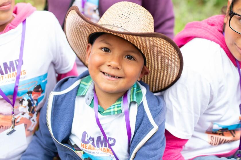 Kid smiling at Camp Camacho