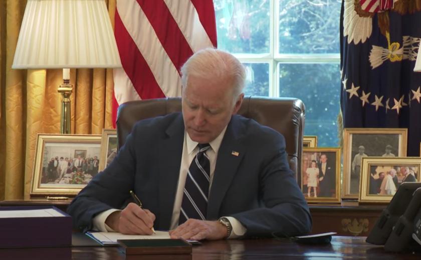President Joe Biden signs the $1.9 trillion stimulus bill Wednesday.